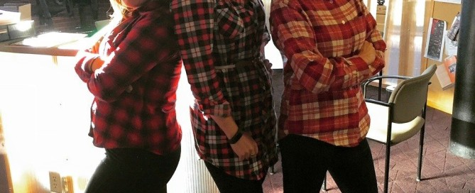 Three people in red plaid shirts