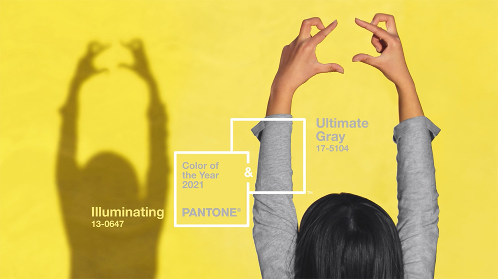 Girl wearing a gray shirt in front of a yellow background